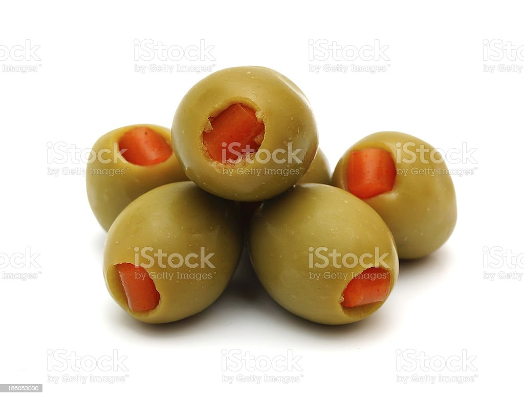 stuffed green olives on a white background stock photo