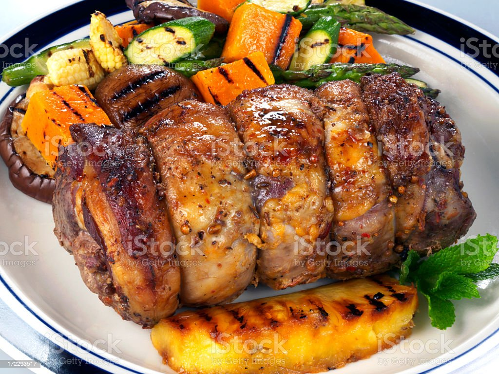 Stuffed lamb roll with grilled veggies royalty-free stock photo