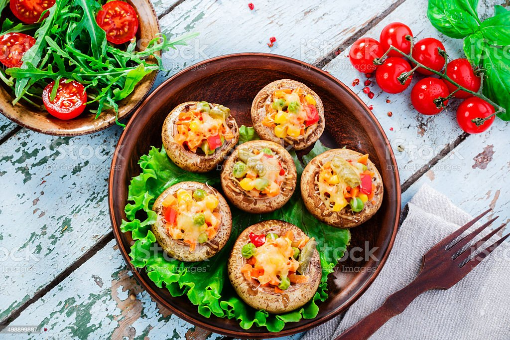 stuffed mushrooms baked with vegetables stock photo