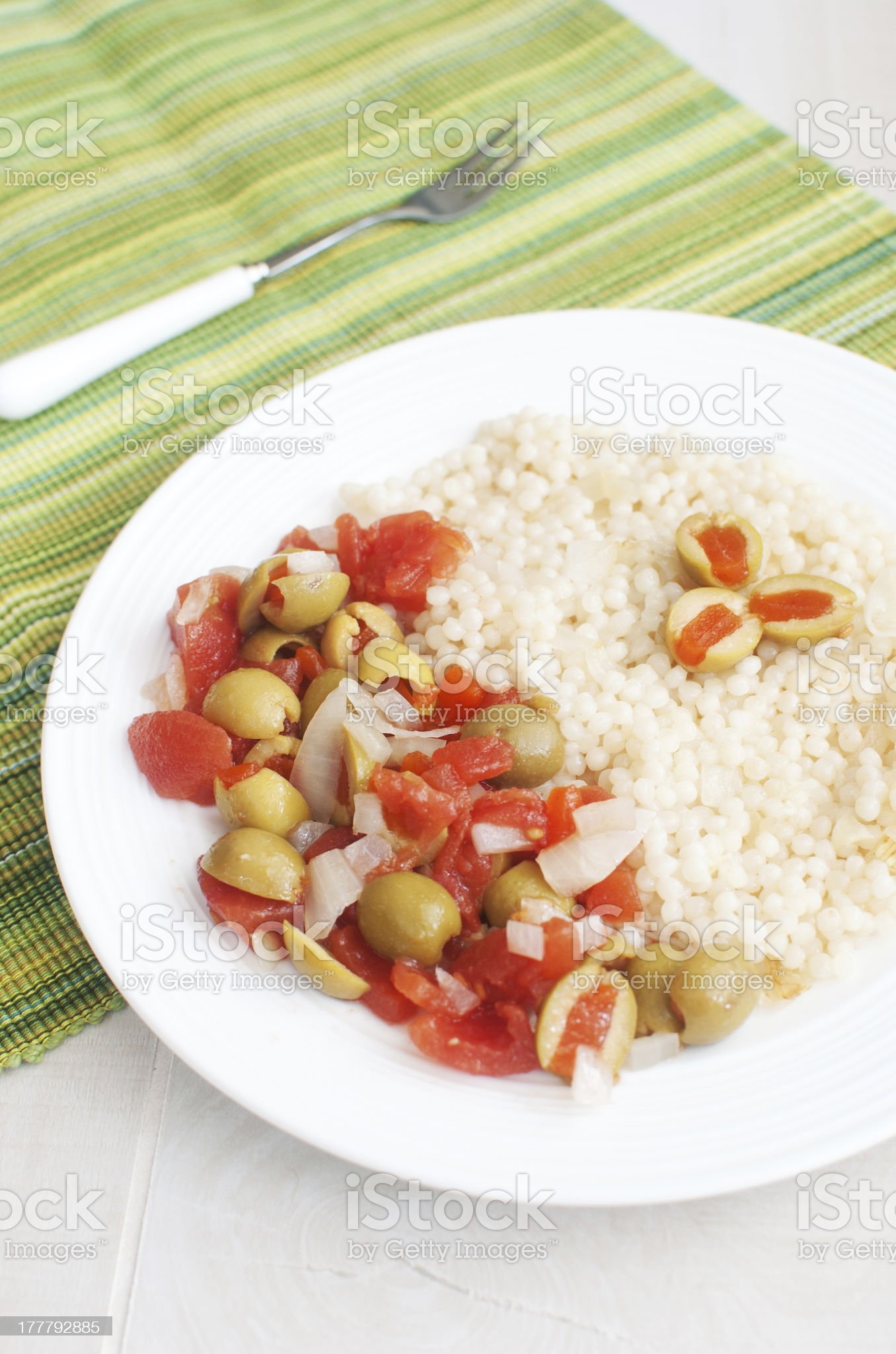 Stuffed olives and tomato salad with couscous royalty-free stock photo