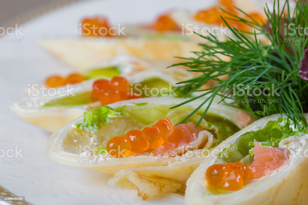 Stuffed pancakes with red caviar stock photo