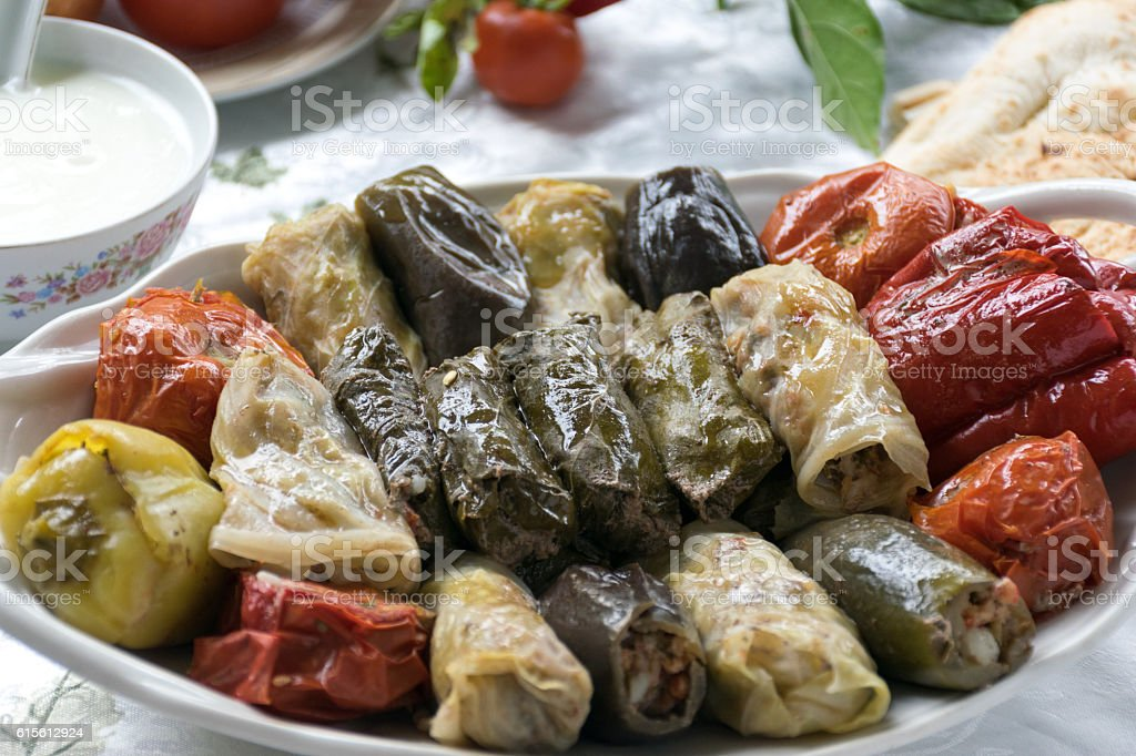 stuffed peppers, cabbage, eggplant, tomatoes, and grape leaves stock photo
