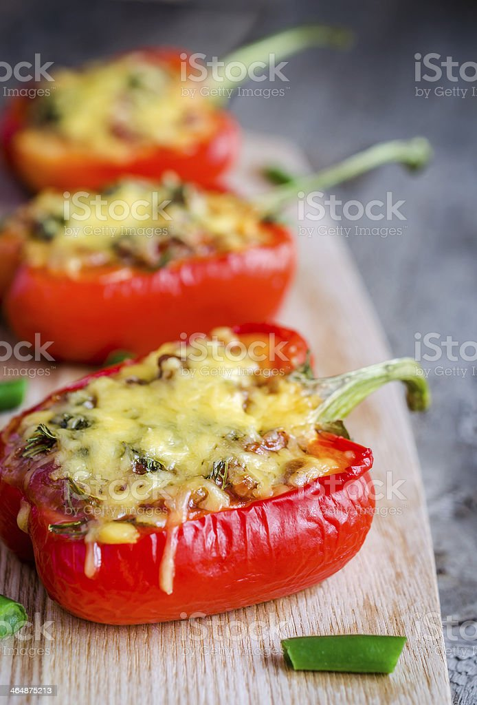 Stuffed peppers with meat presented on a wooden board  stock photo