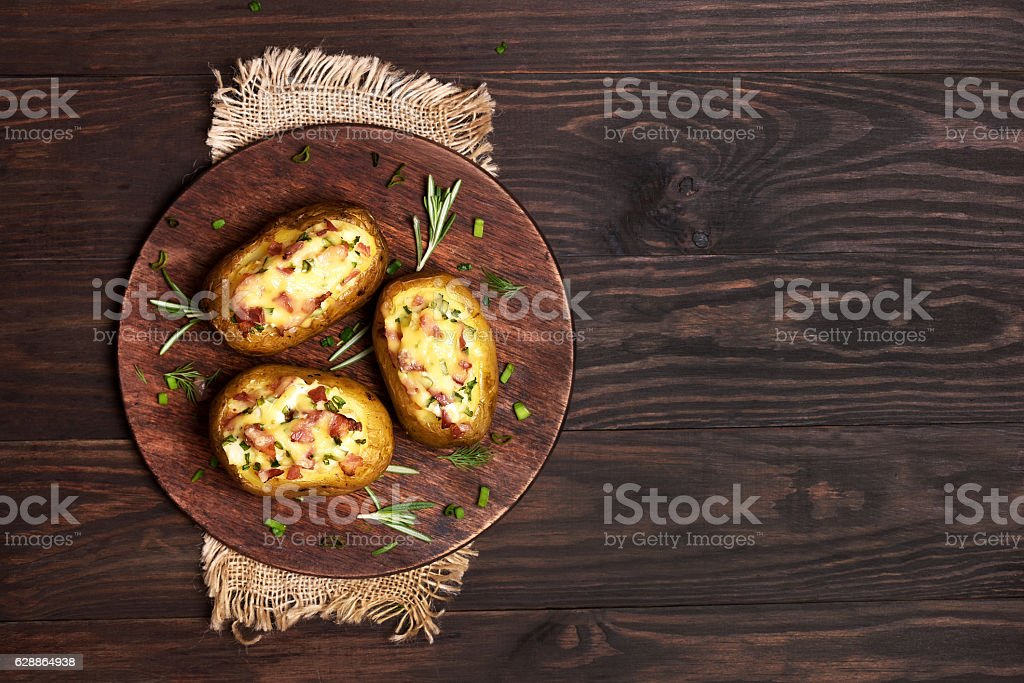 Stuffed potato with bacon, cheese and green onion stock photo