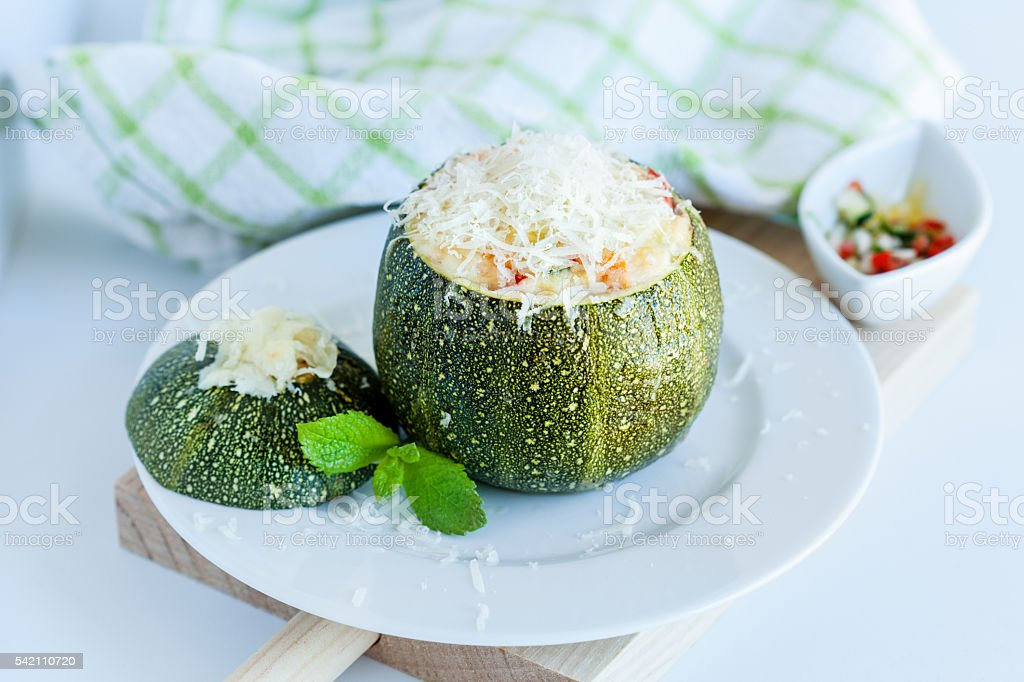Stuffed round courgettes vegetables with bechamel sauce stock photo