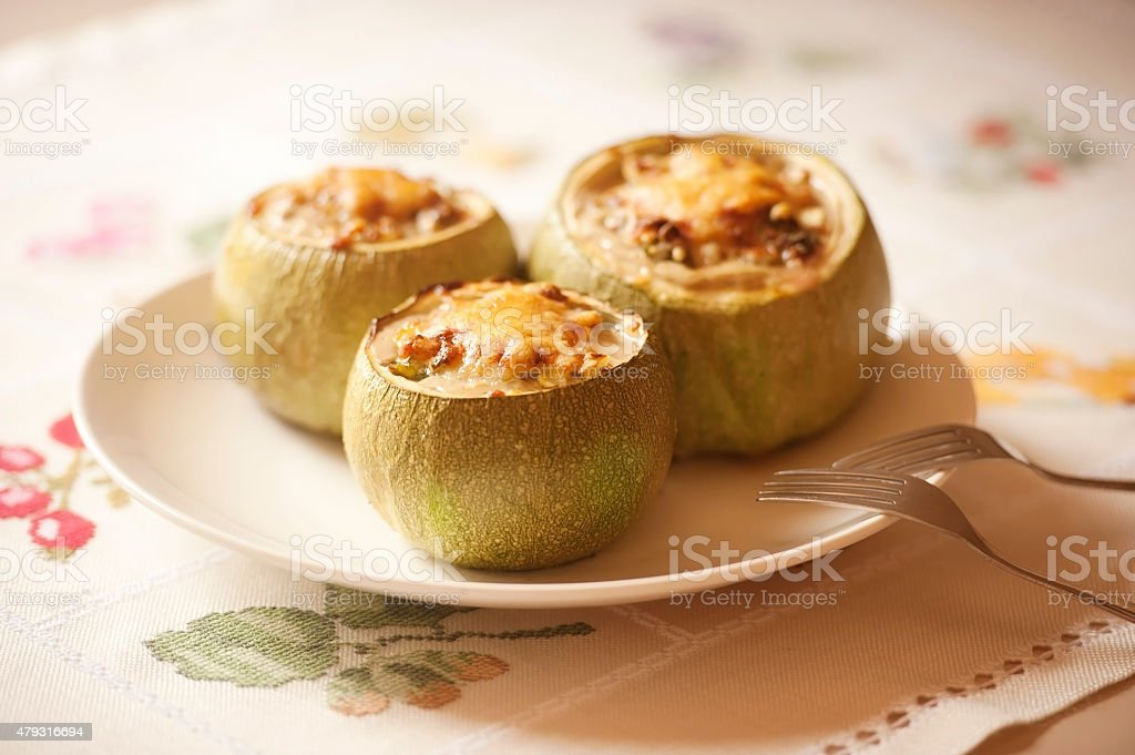 Stuffed round courgettes with grated cheese stock photo