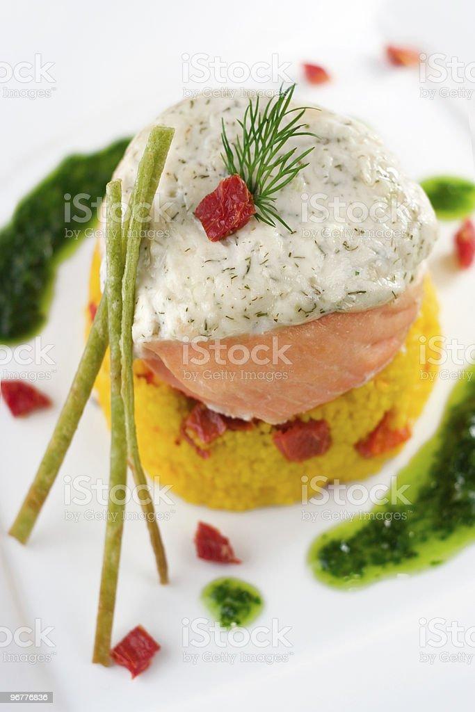 Stuffed Salmon with Saffron Cous-Cous stock photo