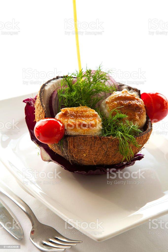 Stuffed Sole service in coconut shell stock photo