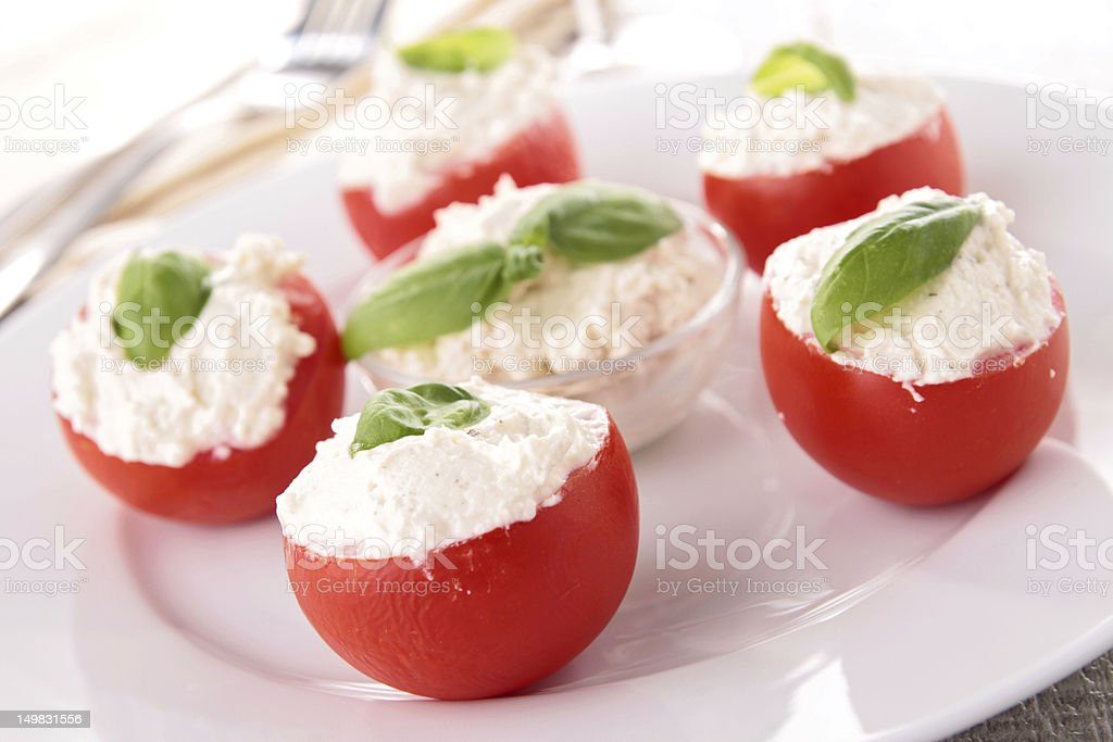 stuffed tomato with cheese and basil royalty-free stock photo