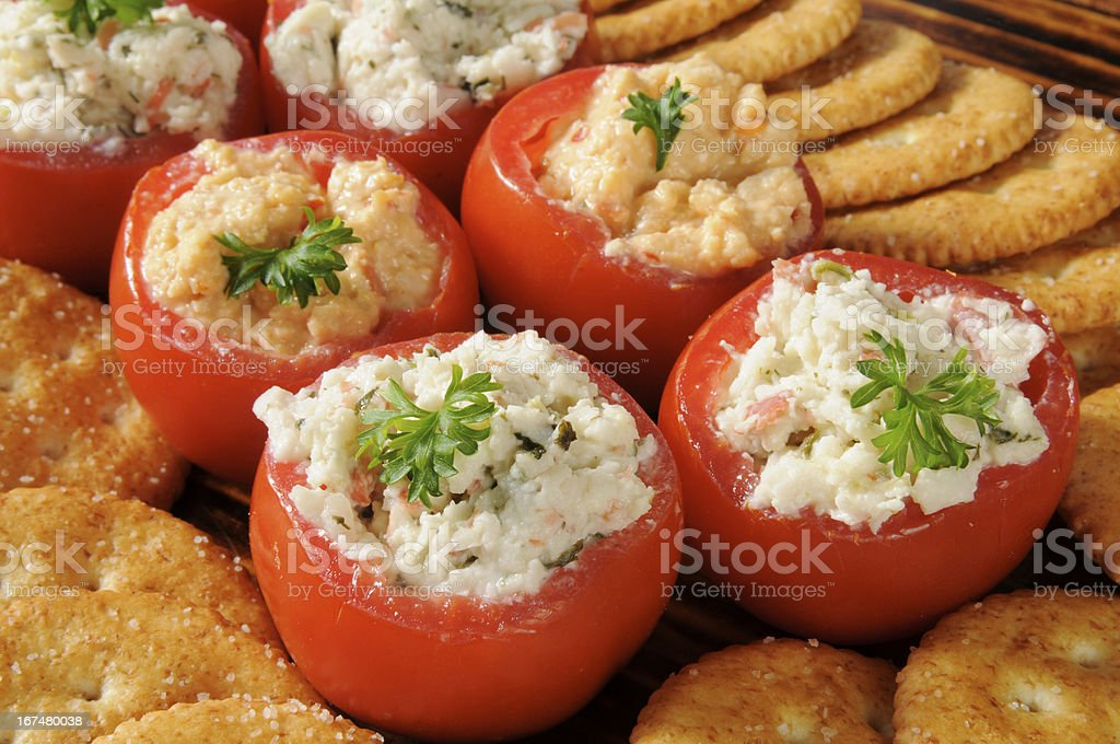 Stuffed tomatoes and crackers stock photo