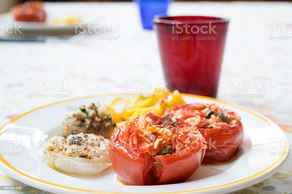 stuffed tomatoes mushrooms and onions stock photo