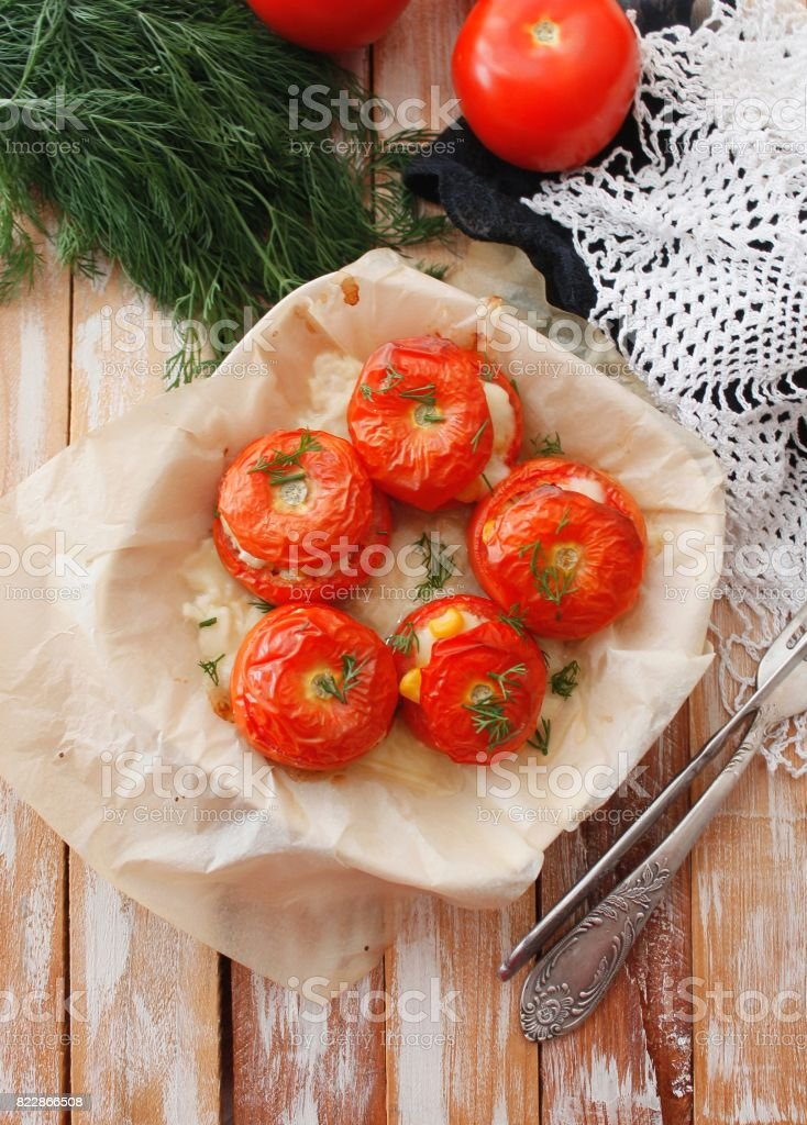 Stuffed tomatoes with rice, corn and vegetables. Dietary appetizer stock photo