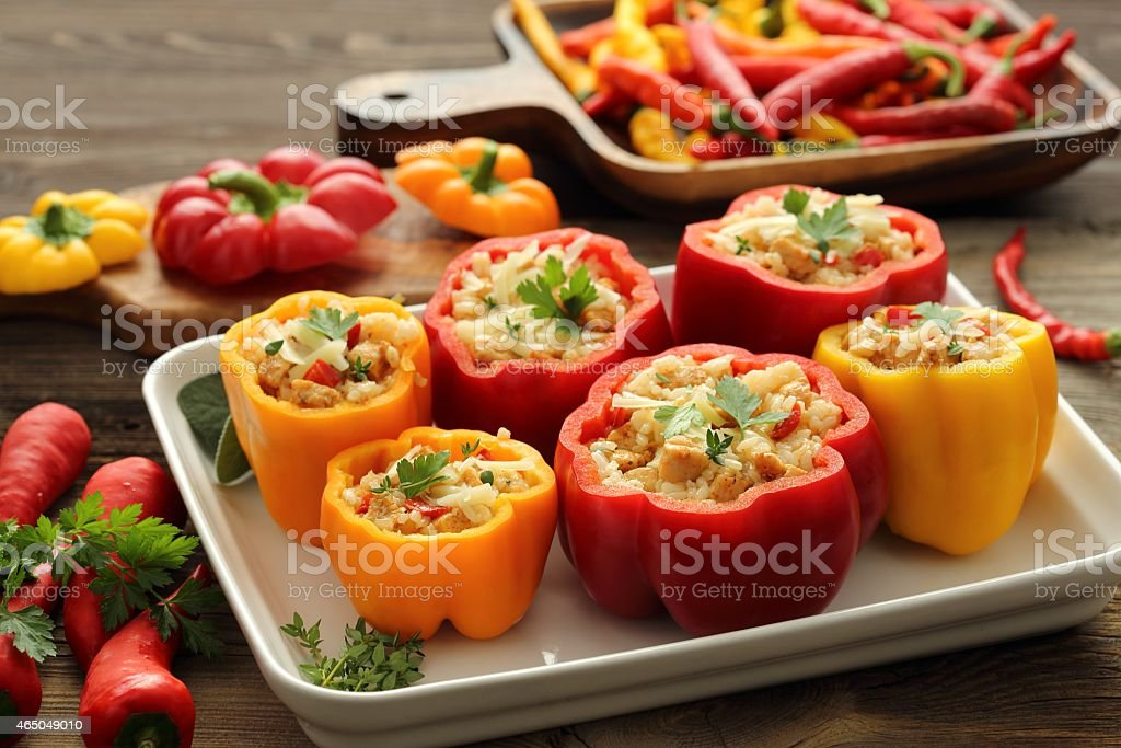 Stuffed yellow and red peppers stock photo