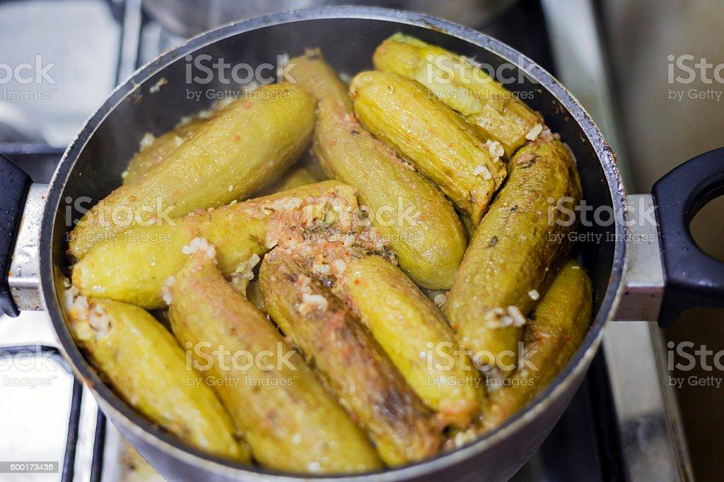 Stuffed zucchini (kousa mahshi) in cookware. stock photo