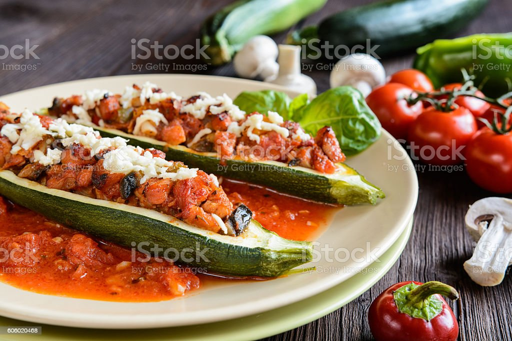 Stuffed zucchini with meat and vegetable stock photo