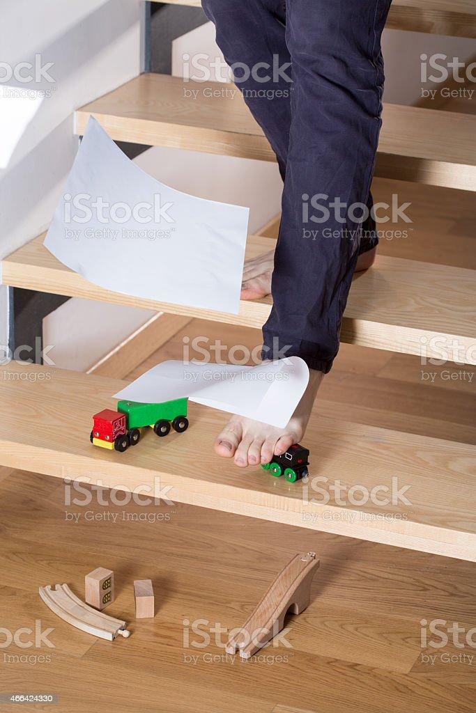 Stumbling on toy car stock photo