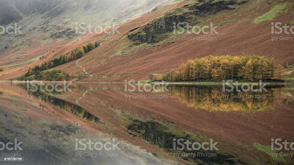 Stuning Autumn Fall landscape image of Lake Buttermere in Lake District England stock photo
