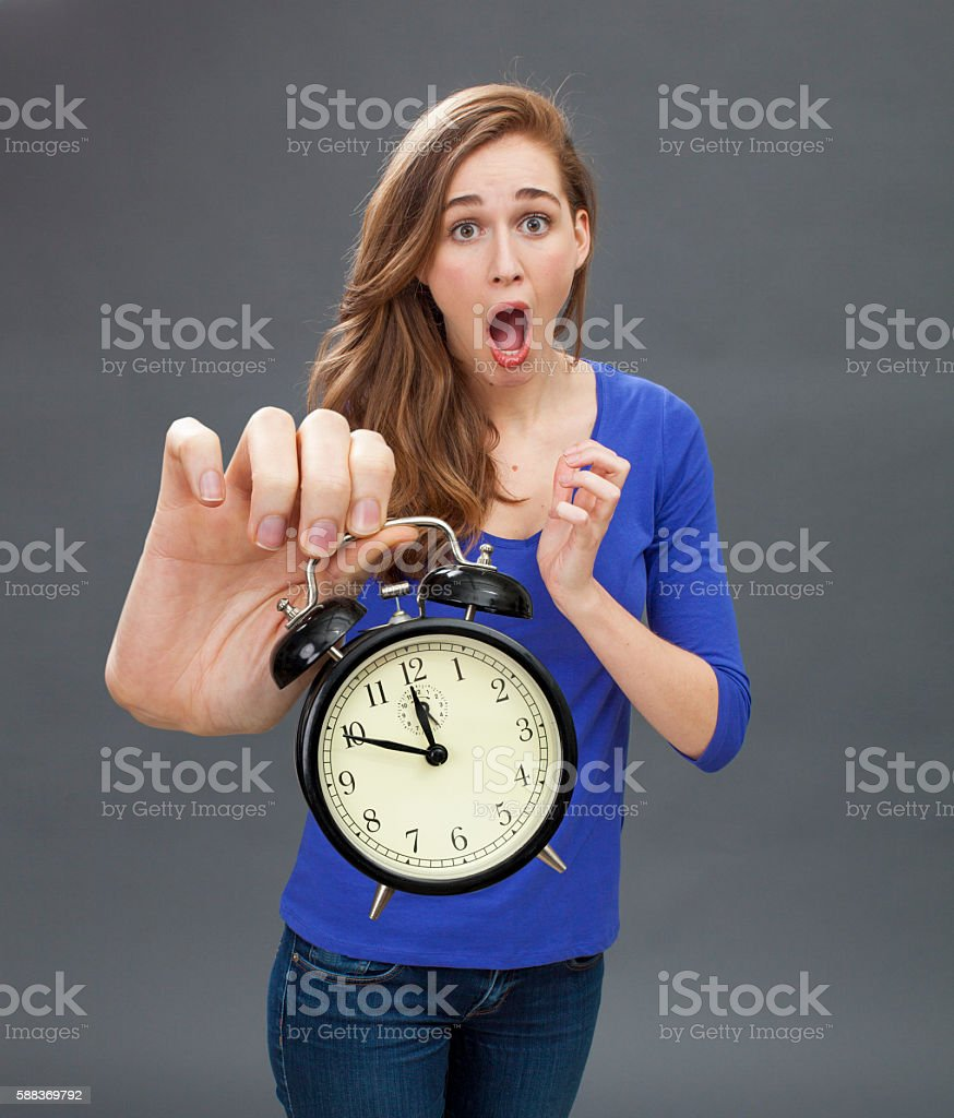 stunned beautiful young woman for emphasis on deadline problem stock photo