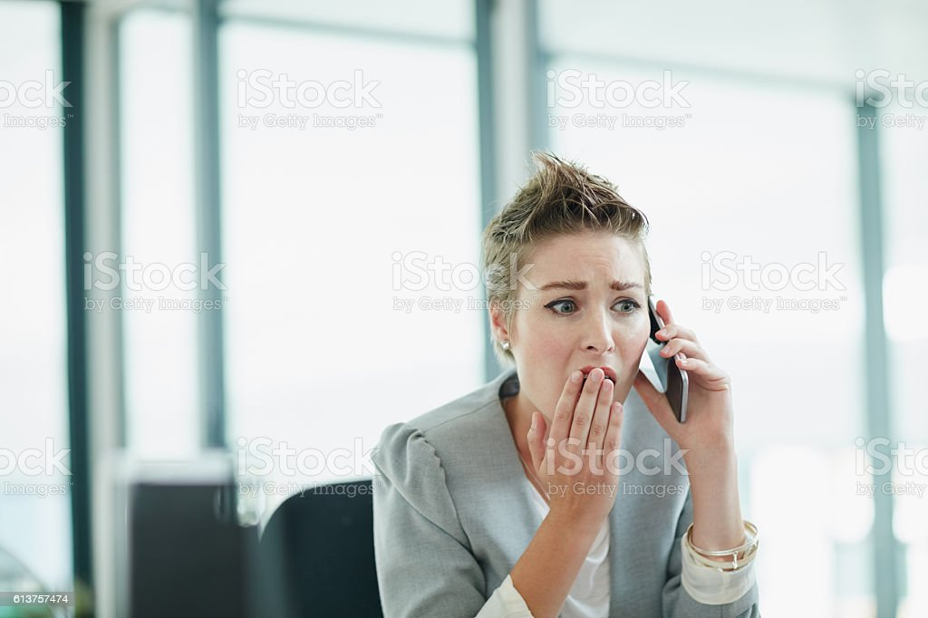 Stunned by what she's hearing stock photo