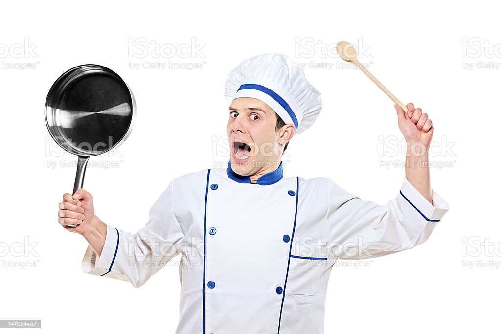 Stunned chef holding kitchen utensil royalty-free stock photo