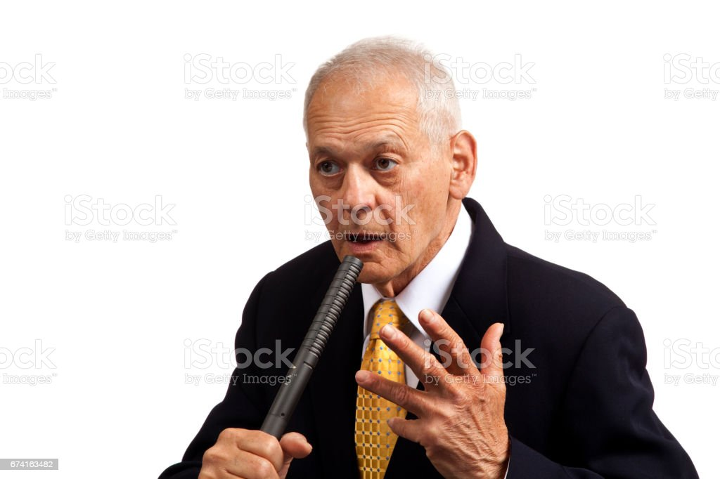 Stunned Politician holding microphone, eyes  glaring, hand in the air, looking right stock photo