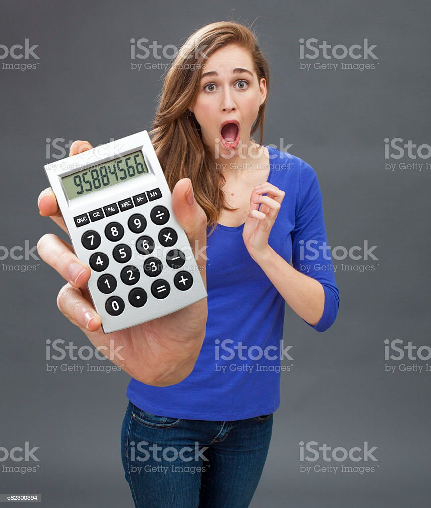 stunned young woman expressing panic, mistake or shocking financial news stock photo