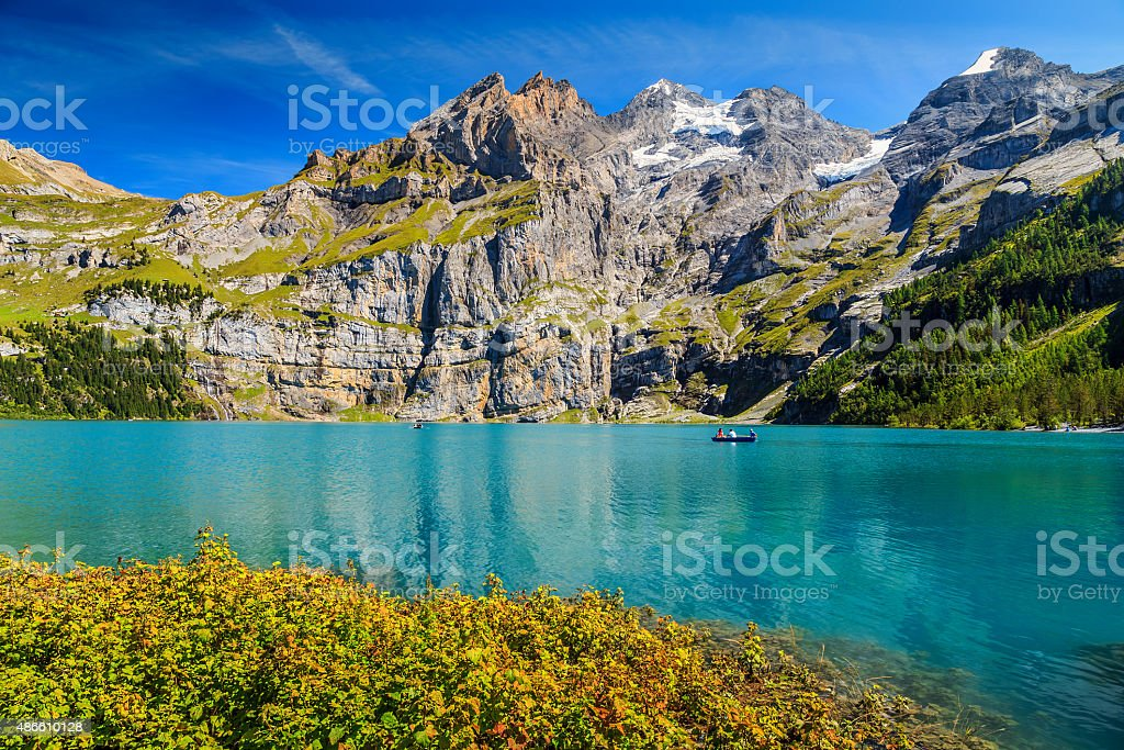 Stunning blue lake with high mountains and glaciers,Oeschinensee,Switzerland stock photo