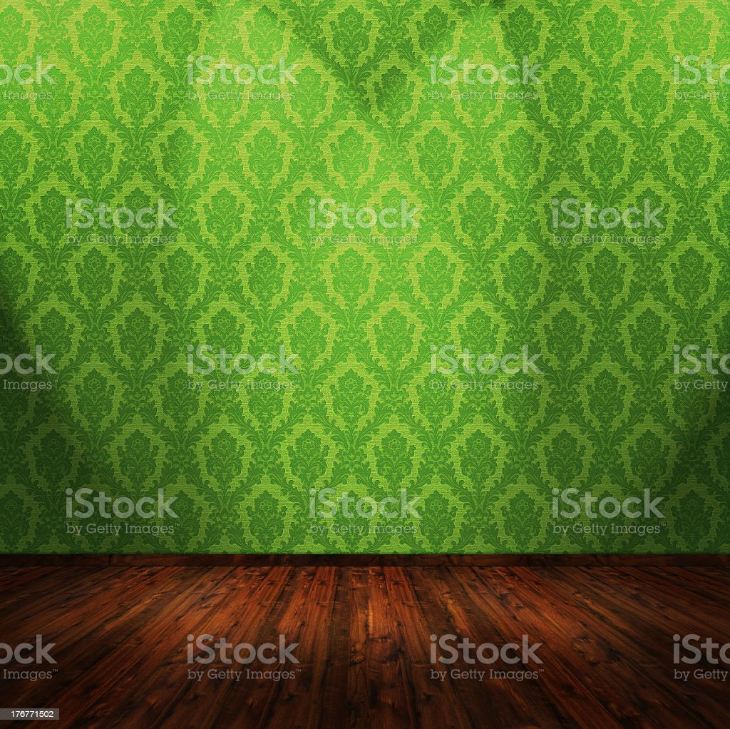 Stunning cherry wood flooring with green damask wall  royalty-free stock photo