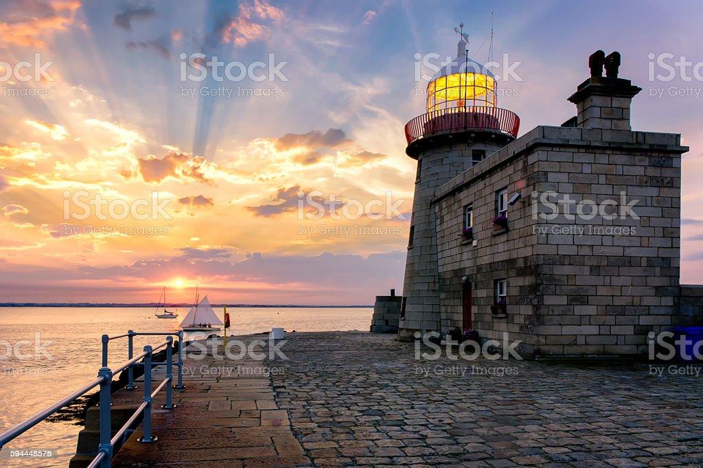Stunning Colorful Sunset over Howth Lighthouse Ireland Landscape stock photo