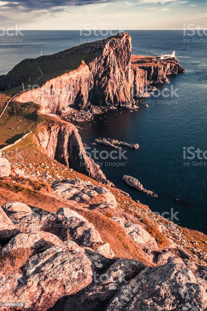 Stunning dusk at the Neist point lighthouse in Scotland stock photo