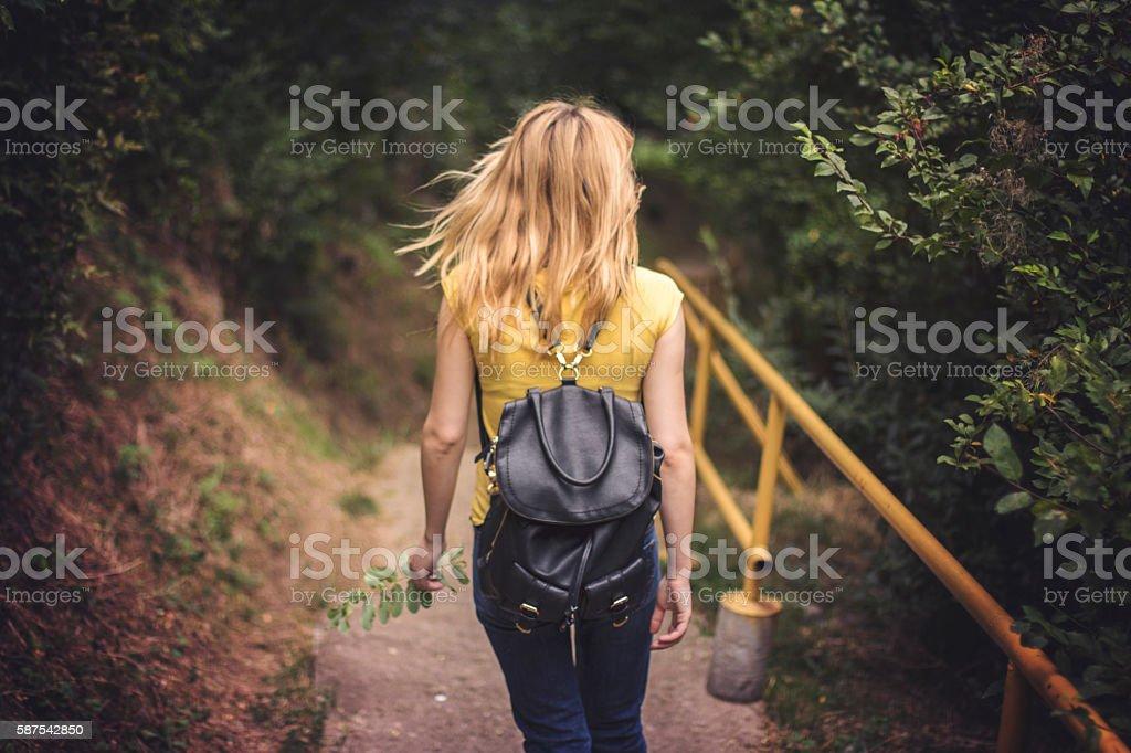 Stunning girl walking on the stairs stock photo