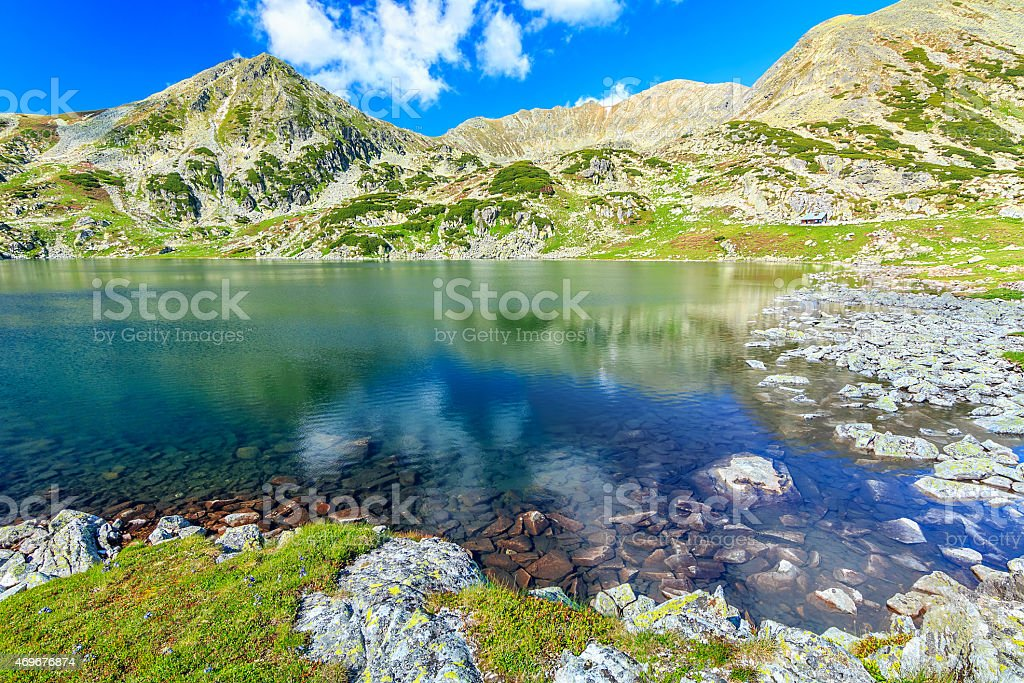 Stunning glacier lake and colorful stones,Retezat mountains,Transylvania,Romania stock photo
