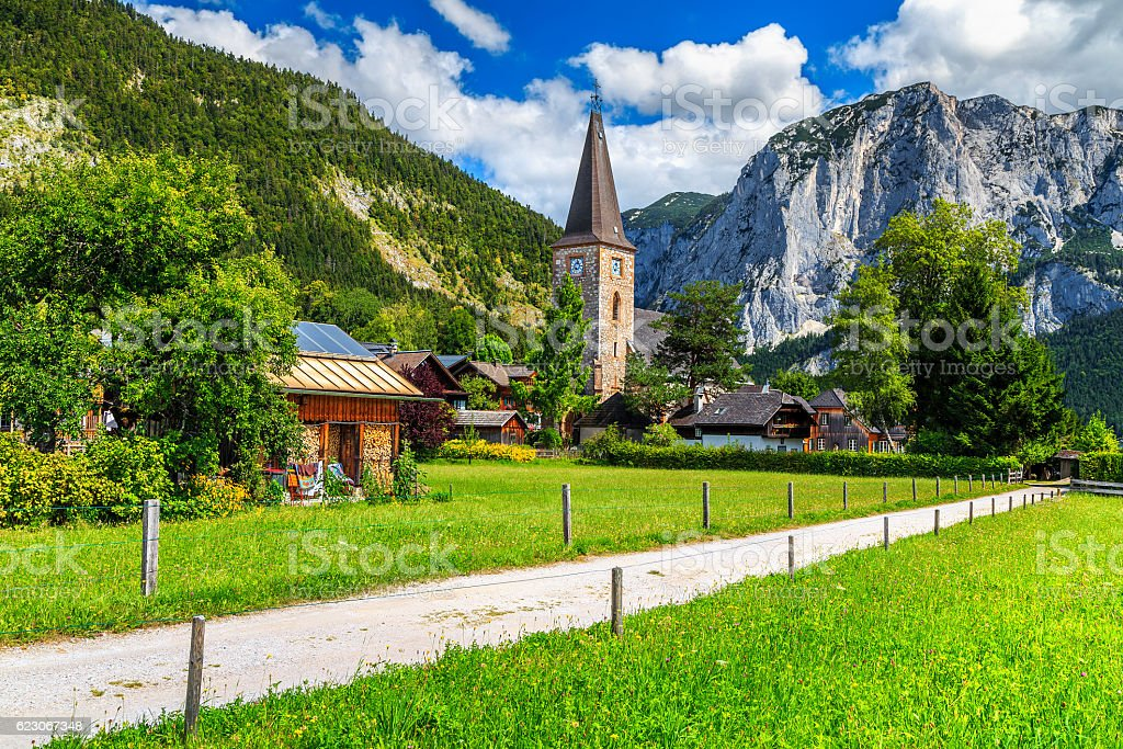 Stunning green field and alpine village with mountains,Altaussee,Austria stock photo