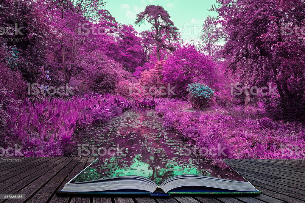 Stunning infrared alternative color landscape image of trees ove stock photo