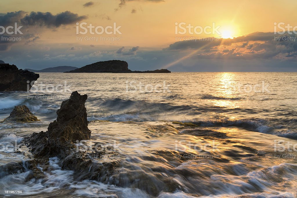 Stunning landscape dawn sunrise with rocky coastline in Mediterranean Sea royalty-free stock photo