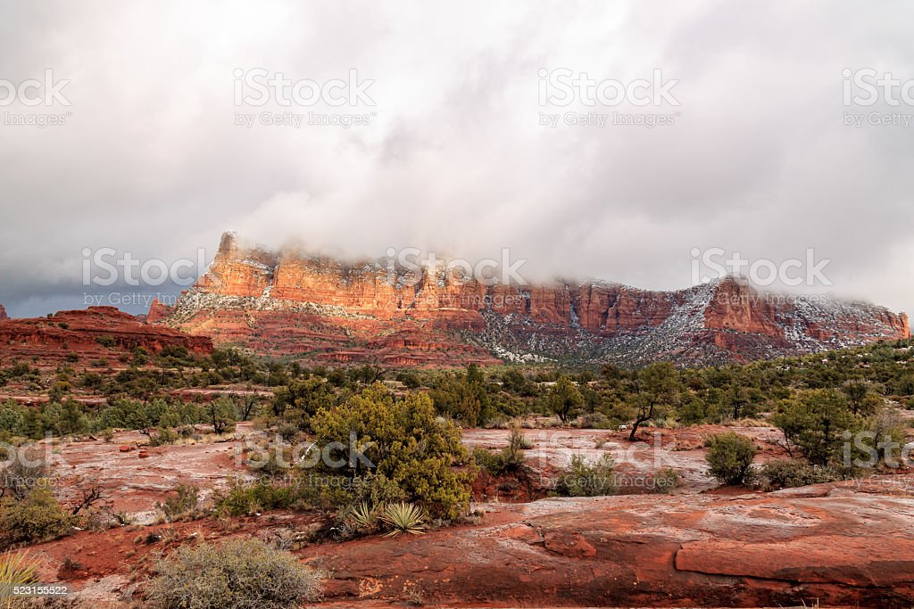 Stunning panorama of Sedona's red sandstone landscape during winter storm stock photo