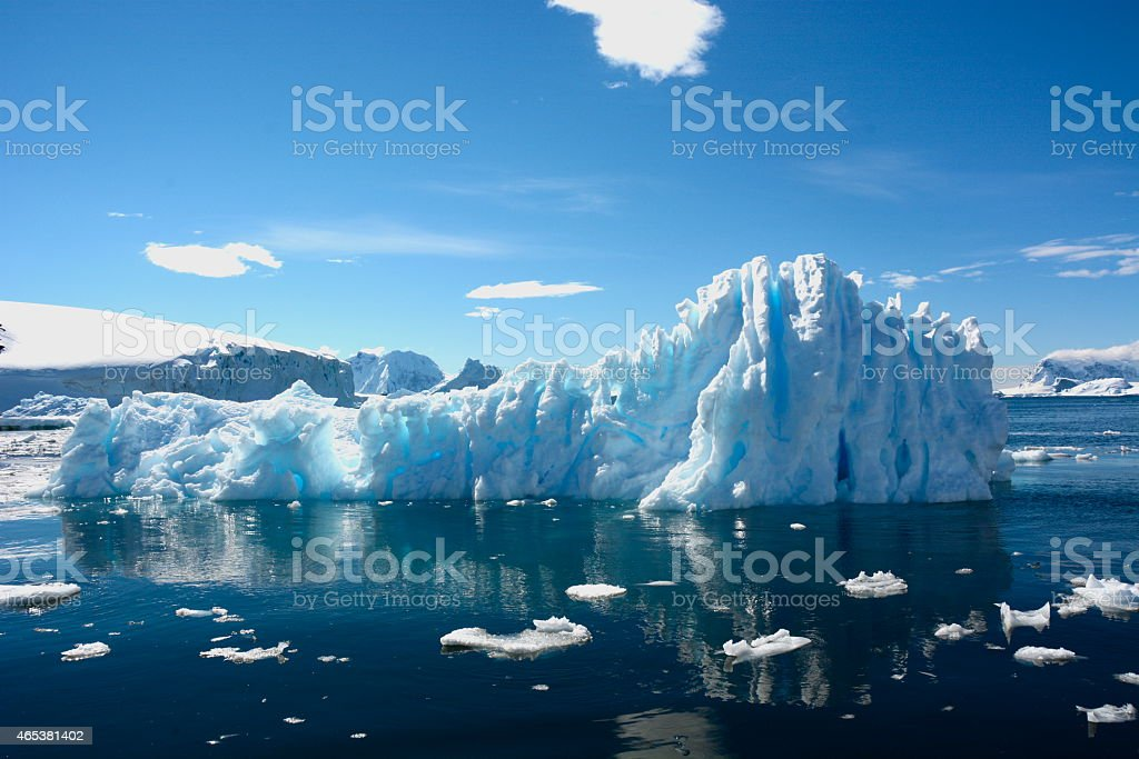 Stunning shot of an iceberg against dark blue waters and sky stock photo