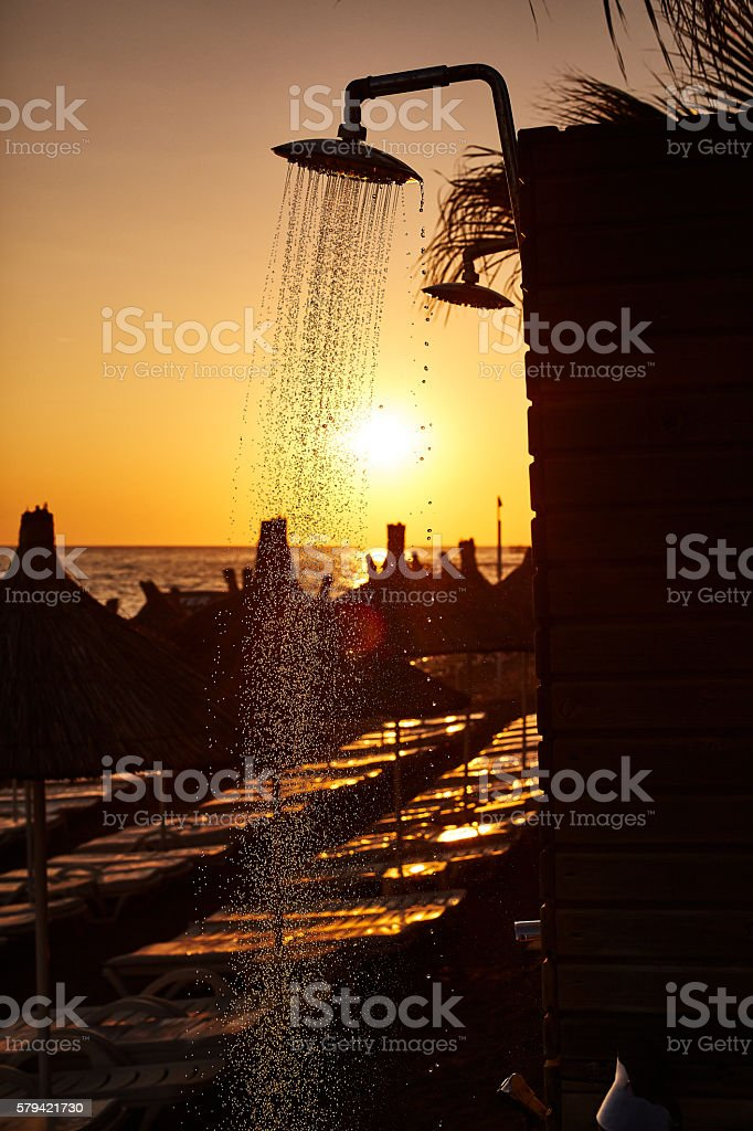 Stunning sunset with tents and outdoor shower stock photo