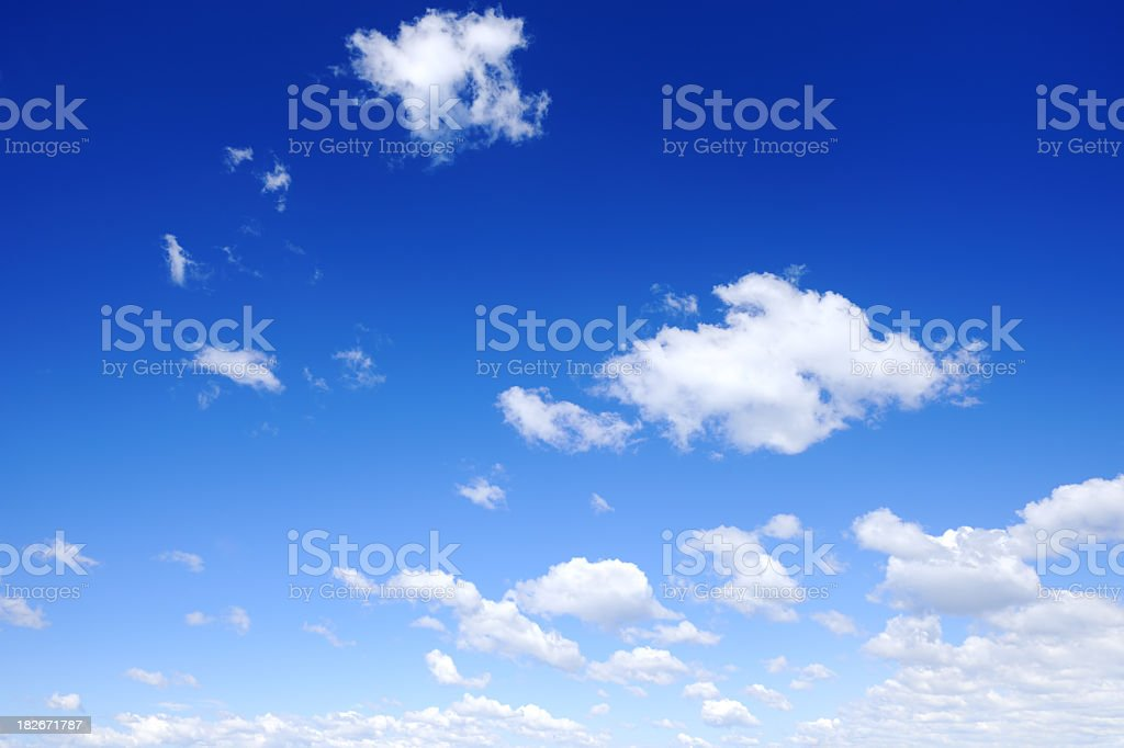 A stunning view of blue skies and fluffy clouds royalty-free stock photo