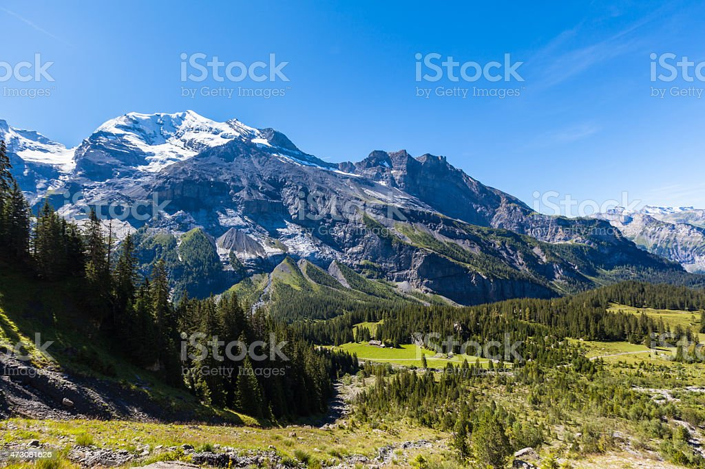 Stunning view of Bluemlisalp and Frundenhorn above Oeschinensee stock photo