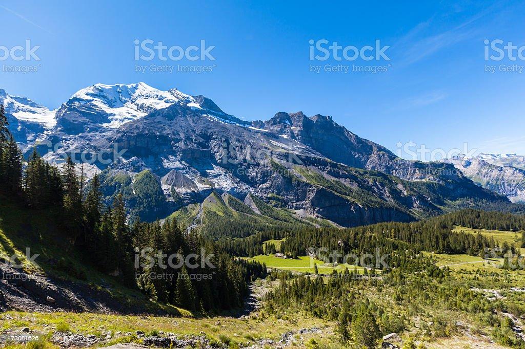 Stunning view of Bluemlisalp and Frundenhorn above Oeschinensee stock photo