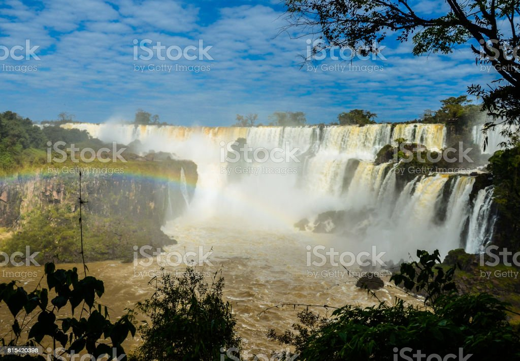 Stunning view of Iguazu waterfalls on a sunny day with the rainbow. Photo taken from the Argentina side. stock photo