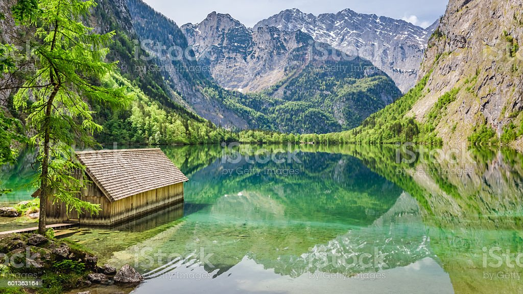 Stunning view of little cottage on the lake Obersee stock photo