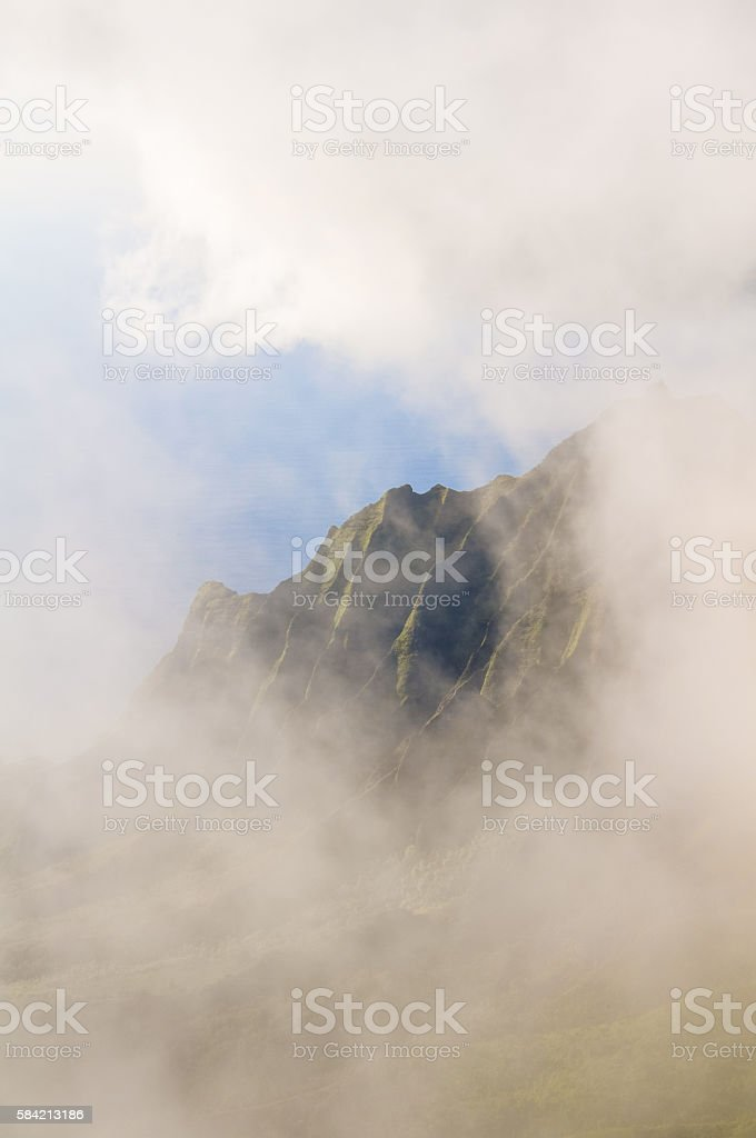 Stunning view through clouds on Kalalau valley mountain ridge stock photo