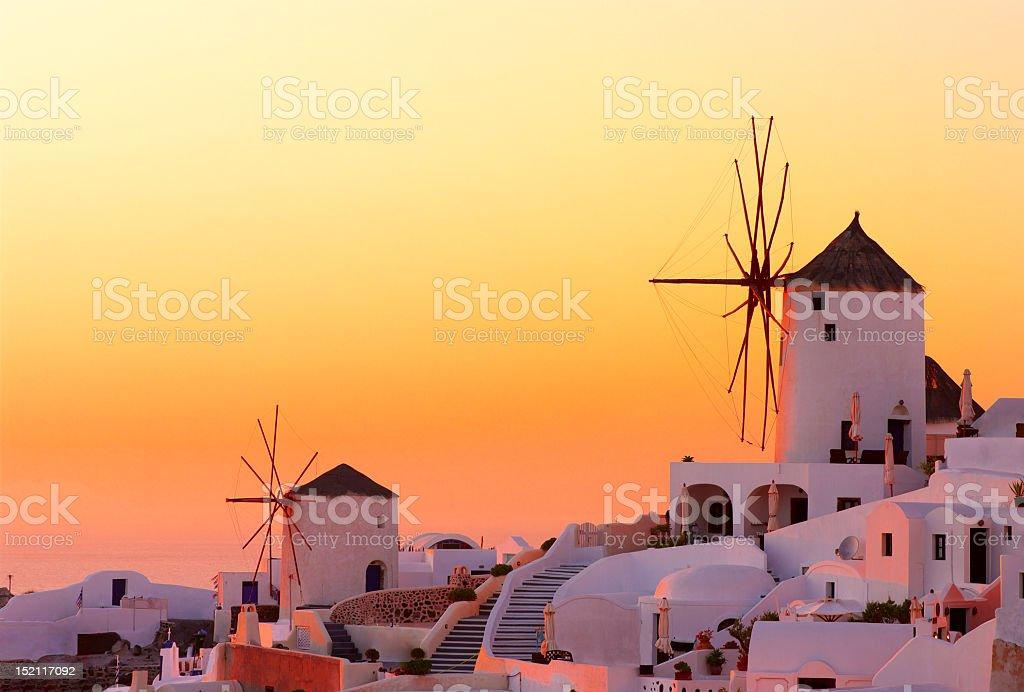 Stunning warm sunset on Oia, Santorini, Greece stock photo