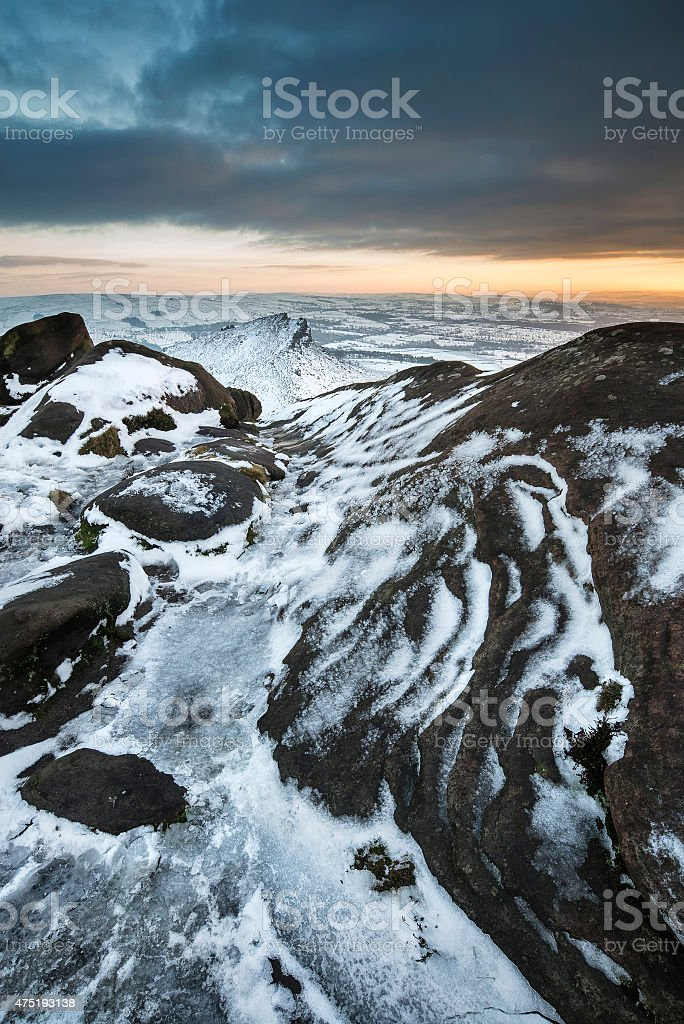 Stunning Winter sunset over countryside landscape with dramatic stock photo