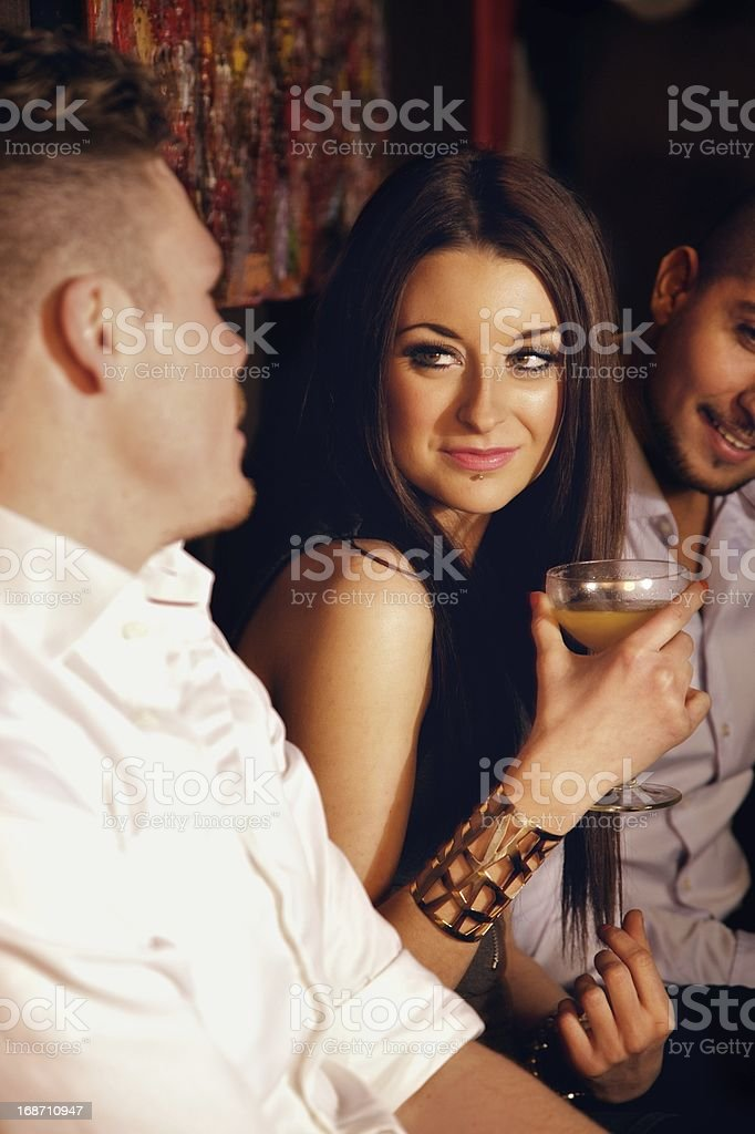Stunning Woman with Male Friends at the Bar stock photo