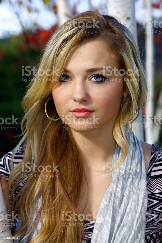 Stunning Young Beauty With A Mona Lisa Smile stock photo
