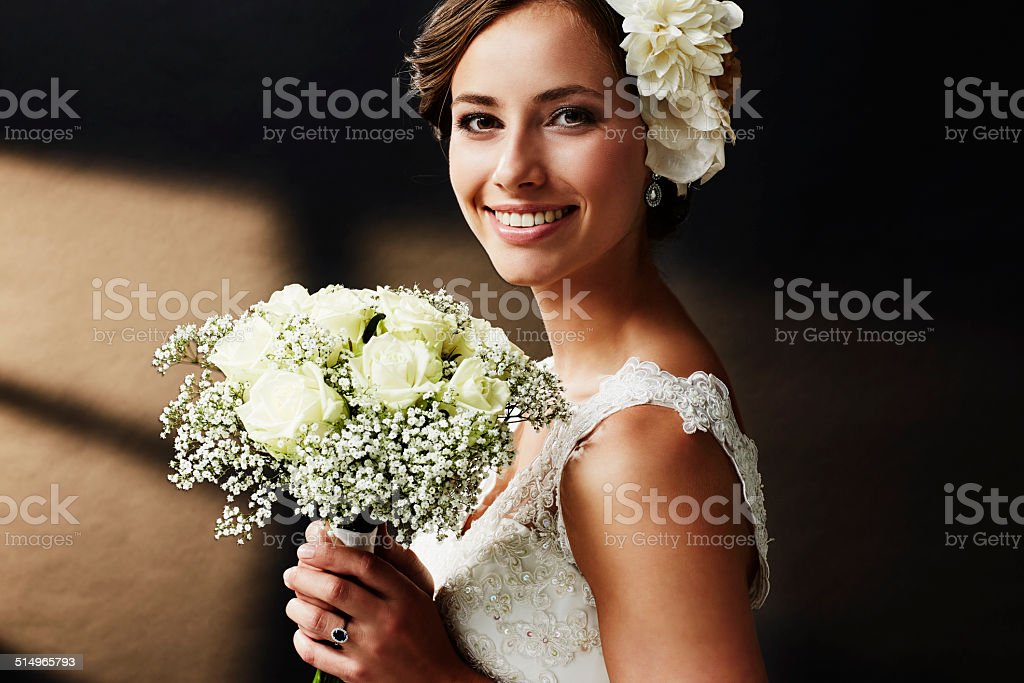 Stunning young bride holding bouquet, portrait stock photo