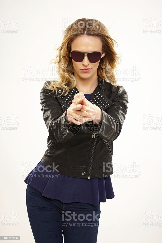 Stunning young female model ready to shoot you down stock photo